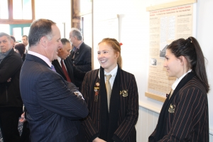 Prime Minister John Key with Baradene College Students and Shared Histories exhibition.